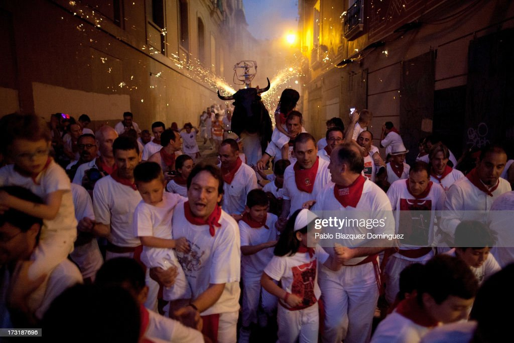 A Toro del Fuego (flaming bull) is run through the streets of Pamplona on the fourth day of the San Fermin Running Of The Bulls festival, on July 9, 2013 in Pamplona, Spain. The annual Fiesta de San Fermin, made famous by the 1926 novel of US writer Ernest Hemmingway 'The Sun Also Rises', involves the running of the bulls through the historic heart of Pamplona, this year for nine days from July 6-14.