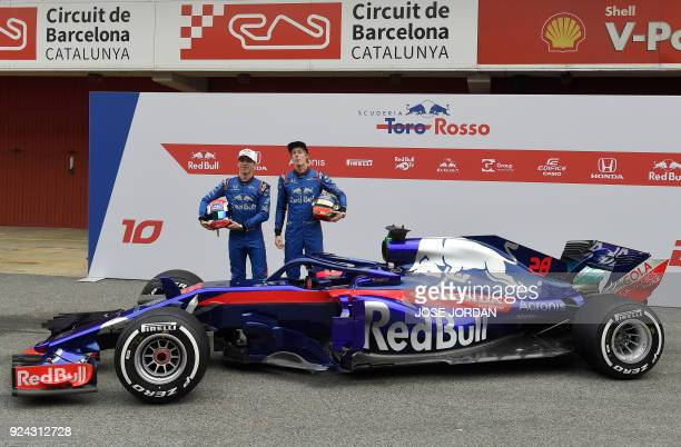 Toro Rosso's French driver Pierre Gasly and Toro Rosso's New Zealand driver Brendon Hartley pose by their new STR13 car during their official...