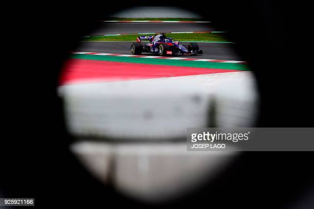 Toro Rosso's French driver Pierre Gasly drives at the Circuit de Catalunya on March 1, 2018 in Montmelo on the outskirts of Barcelona during the...