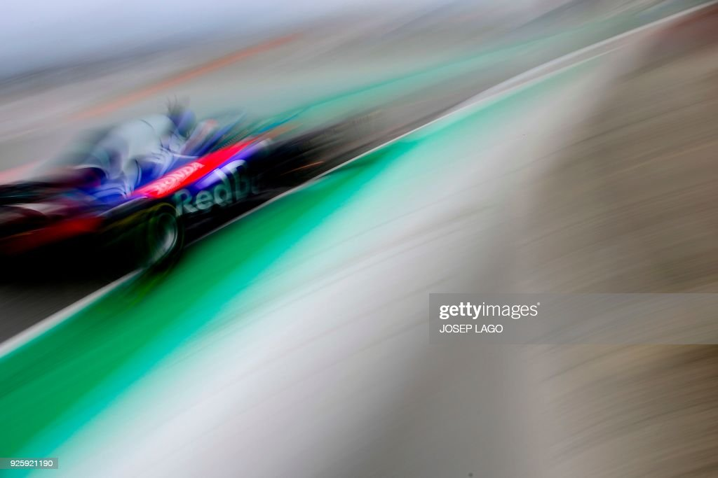 TOPSHOT - Toro Rosso's French driver Pierre Gasly drives at the Circuit de Catalunya on March 1, 2018 in Montmelo on the outskirts of Barcelona during the fourth day of the first week of tests for the Formula One Grand Prix season. / AFP PHOTO / Josep LAGO