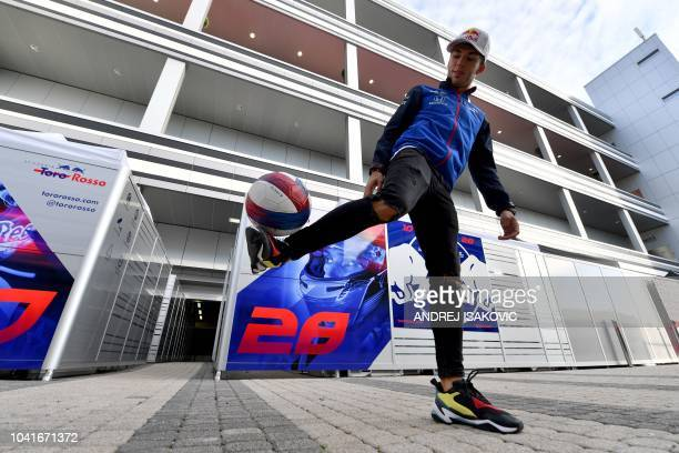 Toro Rosso's French driver Pierre Gasly plays with a ball in the paddock ahead of the Formula One Russian Grand Prix at the Sochi Autodrom circuit in...