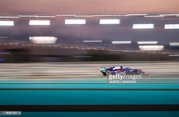 Toro Rosso's French driver Pierre Gasly steers his car at the Yas Marina Circuit in Abu Dhabi during the final race of the Formula One Grand Prix...