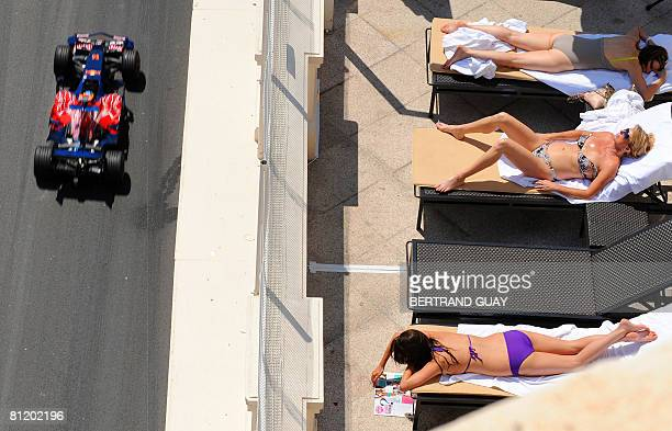 Toro Rosso's French driver Sebastien Bourdais drives at the Monaco racetrack as people enjoy the sun on May 22 2008 in Monte Carlo during the second...