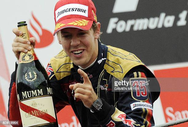 Toro Rosso's German driver Sebastien Vettel celebrates on the podium of the Monza racetrack on September 14 2008 near Milan after the Italian Formula...