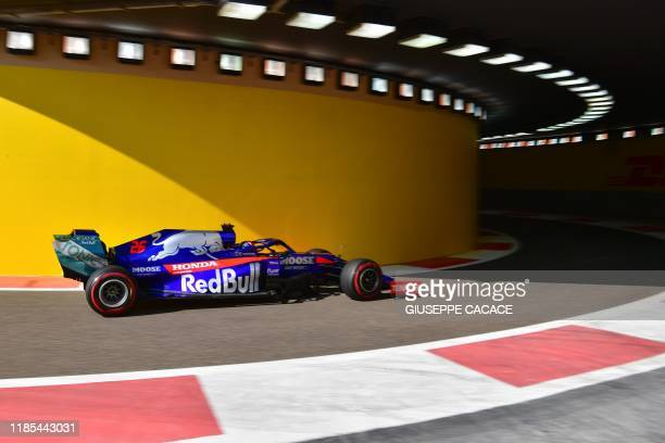 Toro Rosso's Russian driver Daniil Kvyat drives his car during the first practice session on November 29 at the Yas Marina Circuit in Abu Dhabi, two...