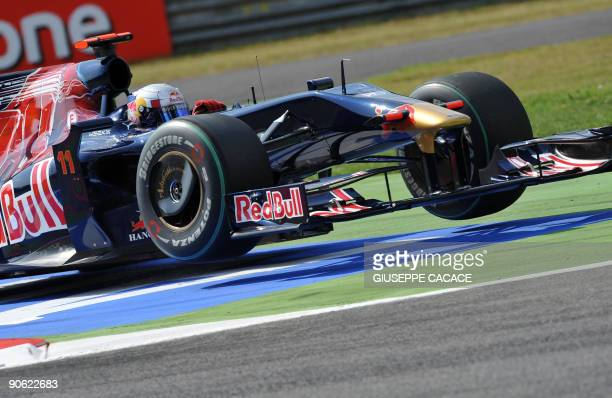 Toro Rosso's Spanish driver Jaime Alguersuari jumps on bumpers as he goes straight in a chicane at the Autodromo Nazionale circuit on September 12,...