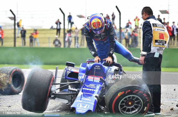 Toro Rosso's Thai driver Alexander Albon gets out from his car after it crashed during the third practice session for the Formula One Chinese Grand...