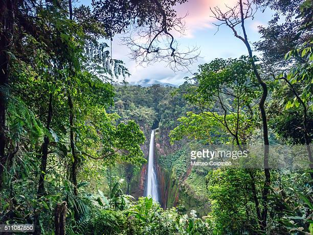 Toro waterfall at sunset, in the green tropical forest of Costa Rica