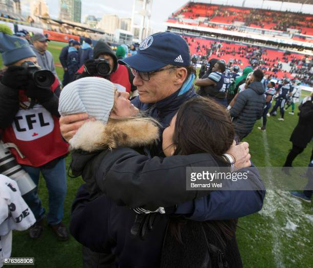 TORONTO ON NOVEMBER 19 Toronto Argo coach Marc Trestman hugs his wife Cindy and daughter Sarahanne after beating Saskatchewan Roughriders 252 in the...
