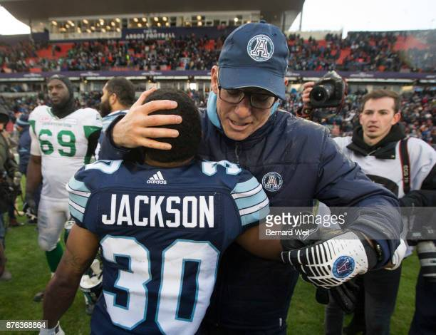 TORONTO ON NOVEMBER 19 Toronto Argo coach Marc Trestman hugs Toronto Argonauts running back Martese Jackson after beating Saskatchewan Roughriders...