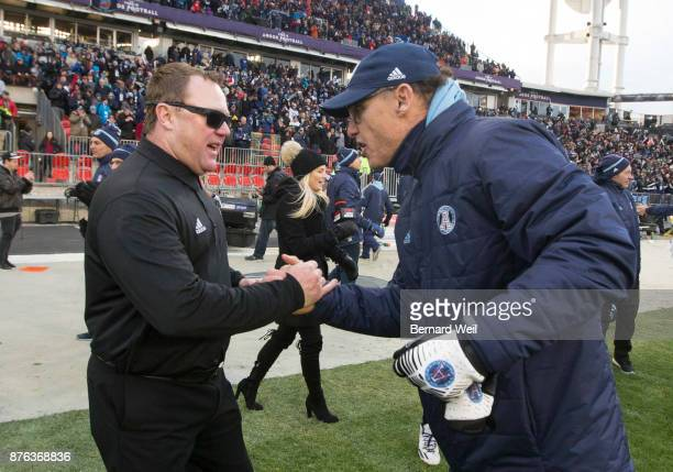 TORONTO ON NOVEMBER 19 Toronto Argo coach Marc Trestman is congratulated by Roughriders coach Chris Jones after beating Saskatchewan Roughriders 252...