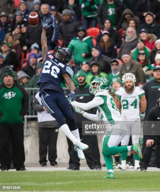 TORONTO ON NOVEMBER 19 Toronto Argonauts defensive back Cassius Vaughn cant make the catch as Saskatchewan Roughriders wide receiver Naaman Roosevelt...