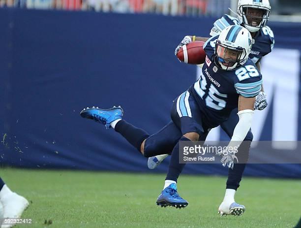 Toronto Argonauts defensive back Isaiah Green loses his footing after an interception as theToronto Argonauts play the Edmonton Eskimos at BMO Field...