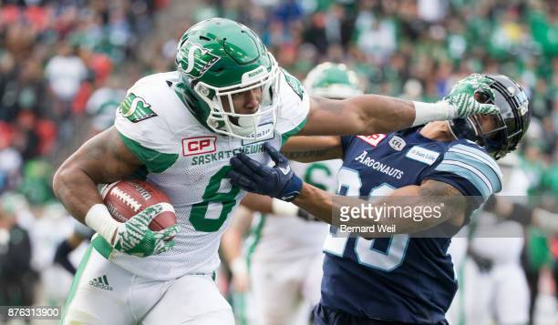 TORONTO ON NOVEMBER 19 Toronto Argonauts linebacker Rico Murray gets a face wash by Saskatchewan Roughriders wide receiver Marcus Thigpen in the 1st...