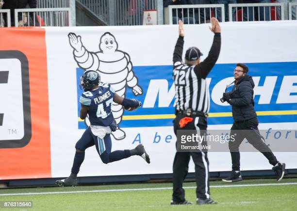 TORONTO ON NOVEMBER 19 Toronto Argonauts linebacker Terrance Plummer gets the first touchdown for the Argos on an interception in the 1st quarter as...