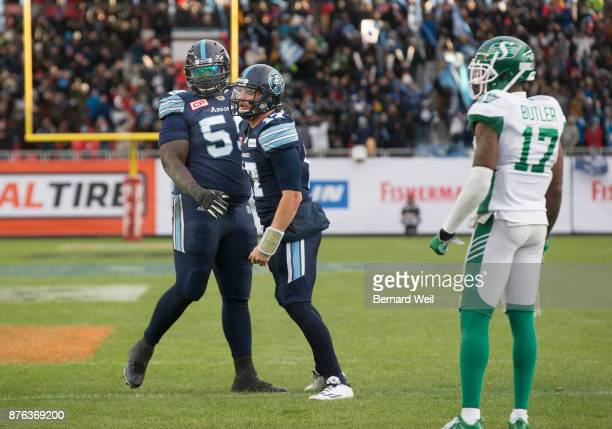 TORONTO ON NOVEMBER 19 Toronto Argonauts quarterback Cody Fajardo is congratulated by Toronto Argonauts offensive lineman Brandon Washington after...