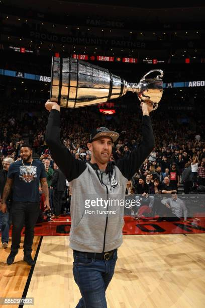 Toronto Argonauts Ricky Ray carries the Grey Cup to the court during the Indiana Pacers game against the Toronto Raptors on December 1 2017 at the...