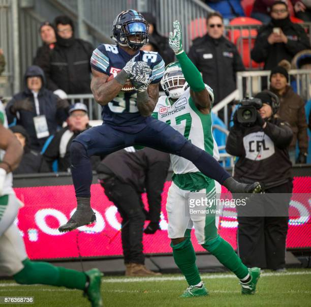 TORONTO ON NOVEMBER 19 Toronto Argonauts running back James Wilder Jr makes the catch over Saskatchewan Roughriders linebacker Samuel Eguavoen to set...