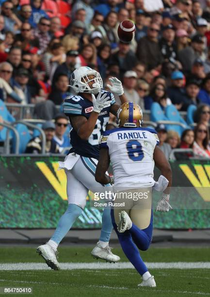 TORONTO ON OCTOBER 21 Toronto Argonauts wide receiver DeVier Posey makes a catch in front of Winnipeg Blue Bombers defensive back Chris Randle as the...