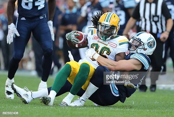 TORONTO ON AUGUST 20 Toronto Argonauts wide receiver Devon Wylie tackles Edmonton Eskimos wide receiver Kenzel Doe Toronto Argonauts play the...
