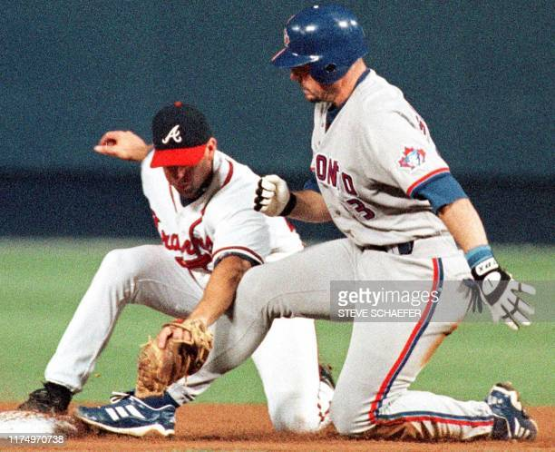 Toronto Blue Jay Ed Sprague is tagged out at second by Atlanta Braves' shortstop Walt Weiss after Sprague tried to turn a sixth inning signal into a...