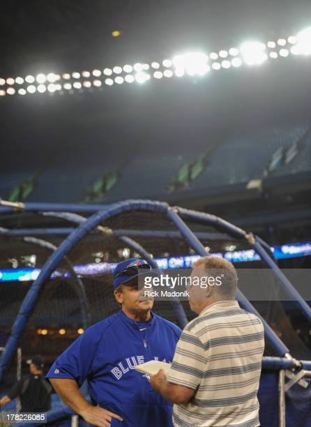 Toronto Blue Jay Manager John Gibbons talks with a reporter after the Jays batting practice in anticipation of tonight's match up against the...