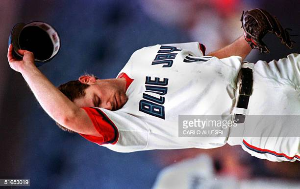 Toronto Blue Jay pitcher Pat Hentgen reacts to a Seattle Mariners Jay Buhner home run but went on to complete the game giving up 3 runs on 11 hits at...