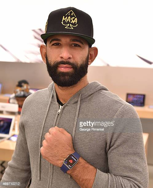 Toronto Blue Jay player Jose Bautista Tries On Apple Watch At The Apple Store in the Eaton Centre Shopping Centre on April 14 2015 in Toronto Canada
