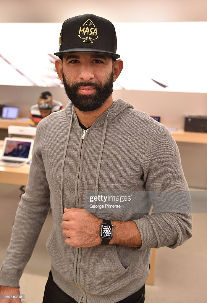 Toronto Blue Jay player Jose Bautista Tries On Apple Watch At The Apple Store Eaton Centre Toronto : News Photo
