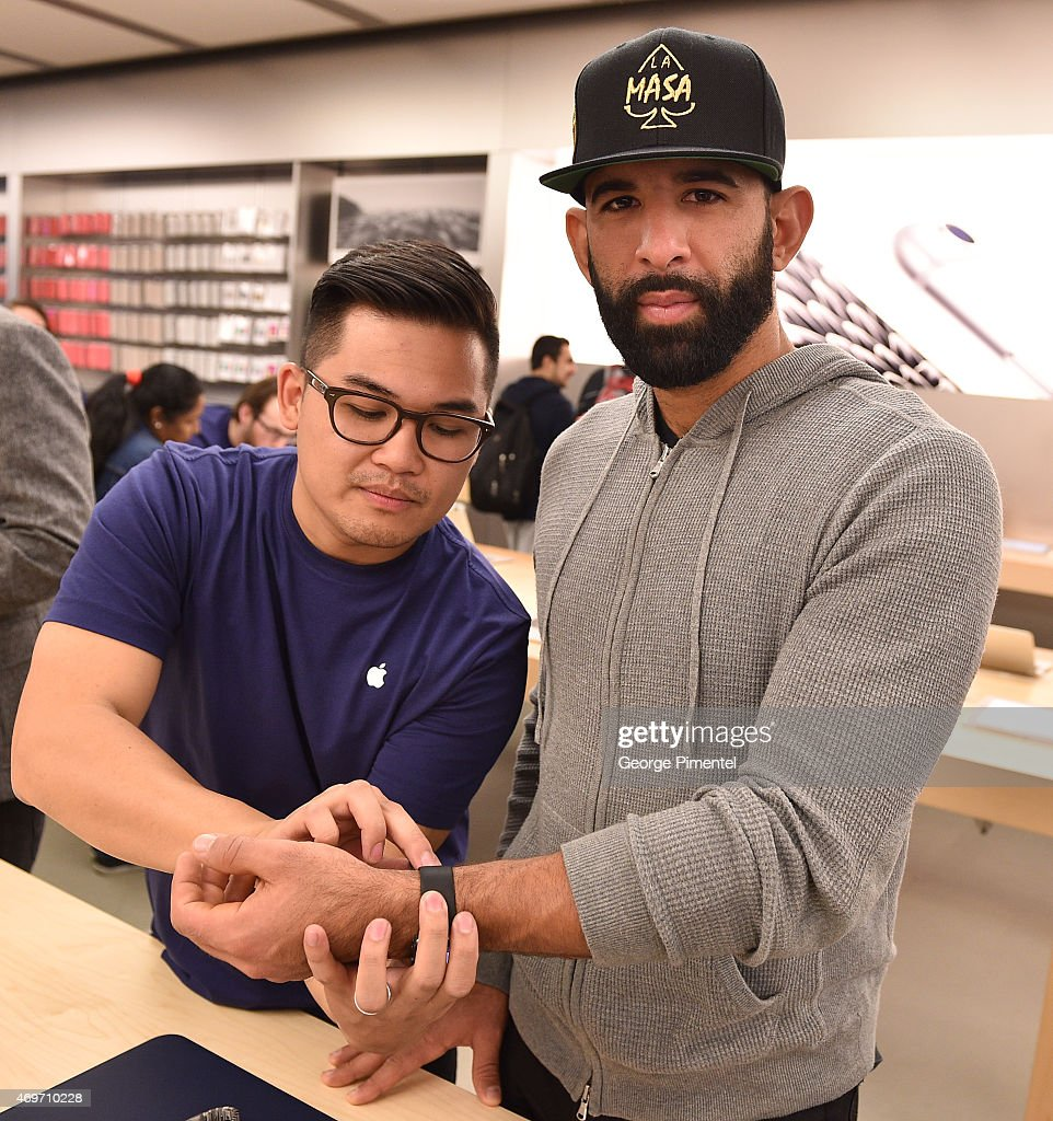 Toronto Blue Jay player Jose Bautista Tries On Apple Watch At The Apple Store in the Eaton Centre Shopping Centre on April 14, 2015 in Toronto, Canada.