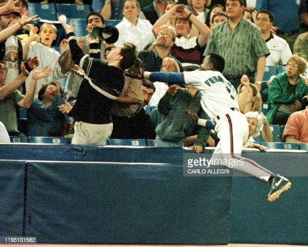 Toronto Blue Jay Tony Fernandez jumps into the stands to catch a foul ball hit by an Oakland A in the early innings of their game at Toronto's...