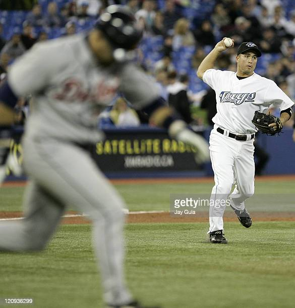 Toronto Blue Jays 3B John McDonald throws out Detroit's Gary Sheffield in MLB action vs the Detroit Tigers at Rogers Centre in Toronto Canada on...