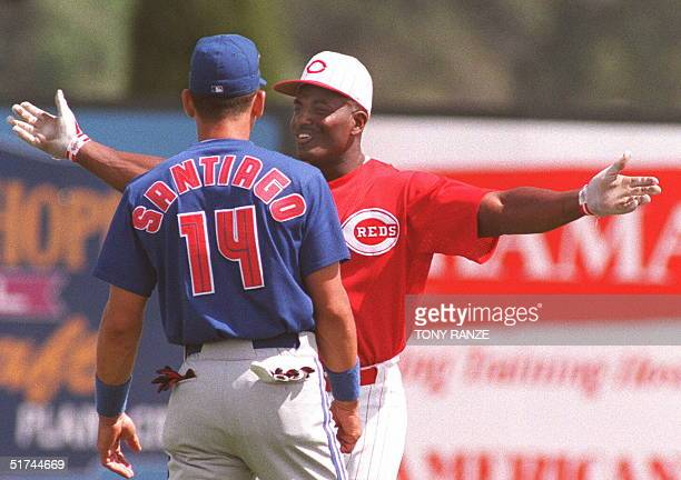 Toronto Blue Jays catcher Benito Santiago and Cincinnati Reds outfielder Ruben Sierra talk as they wait for the start of their spring training game...