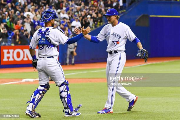 Toronto Blue Jays catcher Josh Thole celebrating his save and Blue Jays win with Toronto Blue Jays relief pitcher Gavin Floyd during the Pittsburgh...
