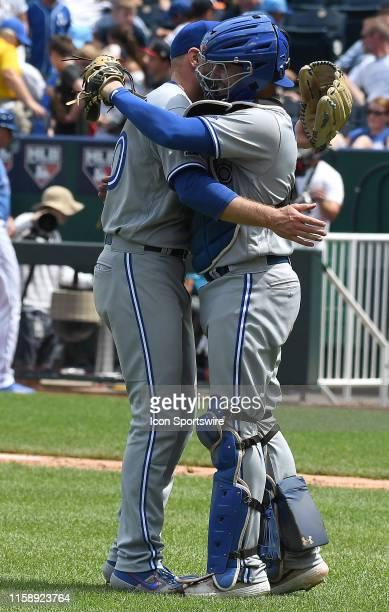 Toronto Blue Jays catcher Reese McGuire congratulates Toronto Blue Jays relief pitcher Joe Biagini after winning a Major League Baseball game between...