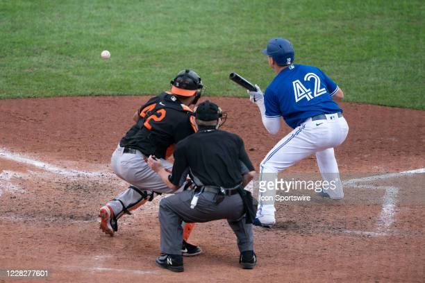 Toronto Blue Jays Catcher Reese McGuire hits a sacrifice bunt during the ninth inning of the Major League Baseball game between the Baltimore Orioles...
