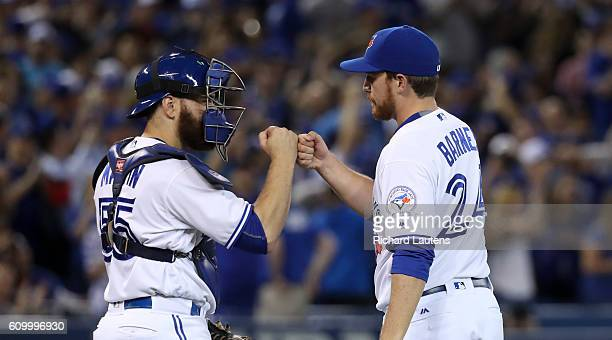 TORONTO ON SEPTEMBER 23 Toronto Blue Jays catcher Russell Martin and Toronto Blue Jays closing pitcher Danny Barnes fist bump after the victory The...