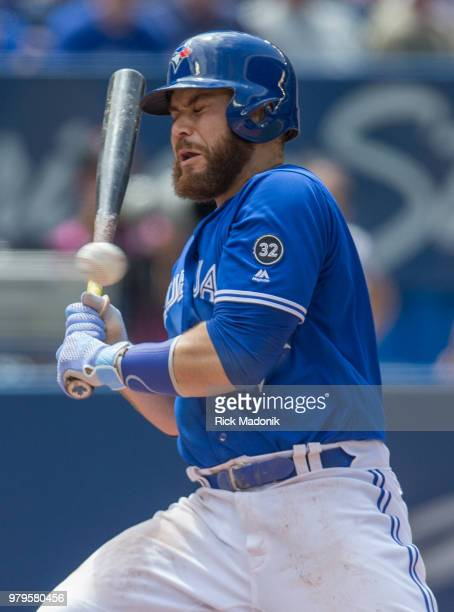 Toronto Blue Jays catcher Russell Martin bails out of a pitch that is high and inside Toronto Blue Jays Vs Atlanta Braves in MLB interleague season...