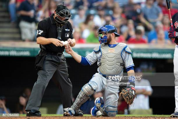 Toronto Blue Jays catcher Russell Martin gets a new baseball from umpire Scott Barry during the fifth inning of the Major League Baseball game...