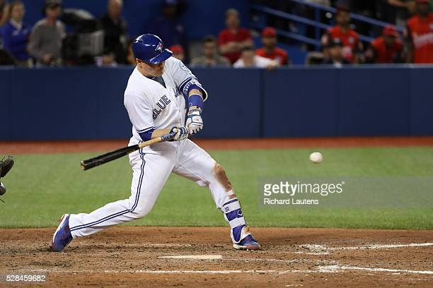 TORONTO ON MAY 4 Toronto Blue Jays catcher Russell Martin swings at the winning pitch as he hits a single to win the game The Toronto Blue Jays beat...