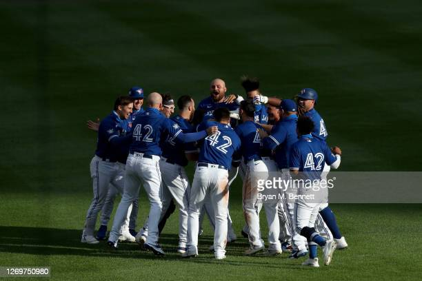 Toronto Blue Jays celebrate after Teoscar Hernandez hit a walk-off two run single to defeat the Baltimore Orioles 6-5 at Sahlen Field on August 30,...