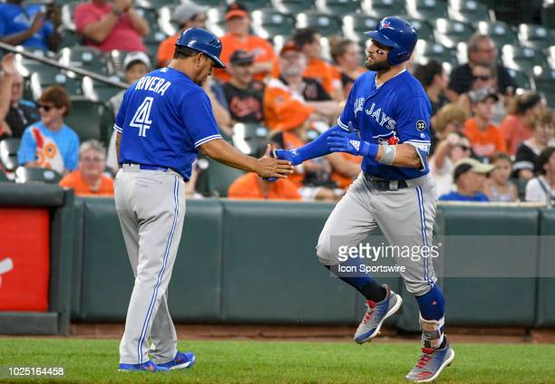 Toronto Blue Jays center fielder Kevin Pillar is congratulated by third base coach Luis Rivera after his second inning solo home run during the game...