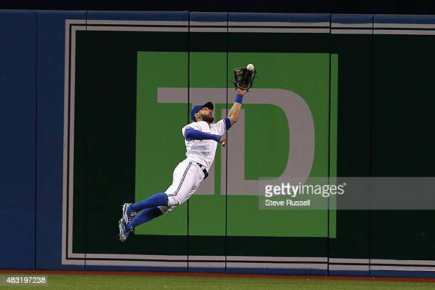 TORONTO ON AUGUST 6 Toronto Blue Jays center fielder Kevin Pillar makes a leaping catch on Miguel Sano in to record the last out of the top of the...