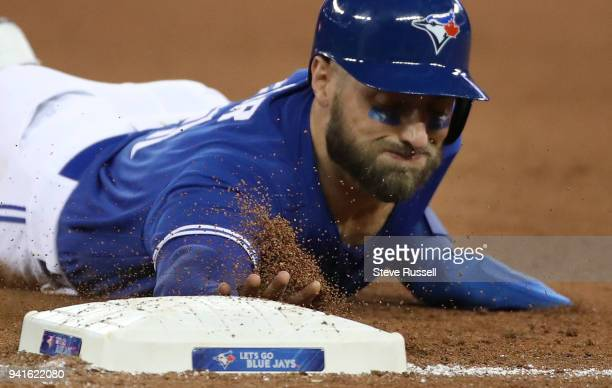 TORONTO ON APRIL 3 Toronto Blue Jays center fielder Kevin Pillar slides back into first as the Toronto Blue Jays beat the Chicago White Sox 145 at...