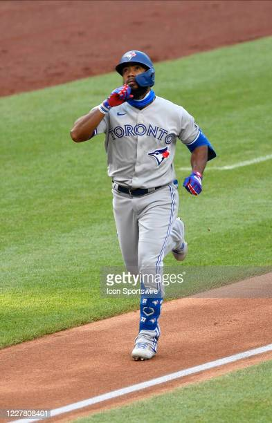 Toronto Blue Jays center fielder Teoscar Hernandez celebrates after rounding third base after he hit a home run during the first at bat of the game...