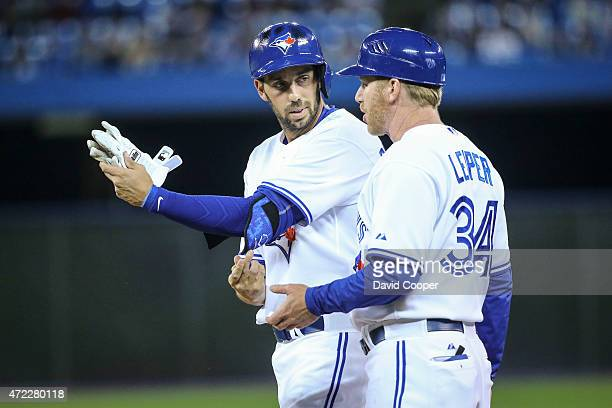 TORONTO ON MAY 5 Toronto Blue Jays Chris Colabello talks with Tim Leiper after he gets his first hit in his first plate appearance for the Jays...