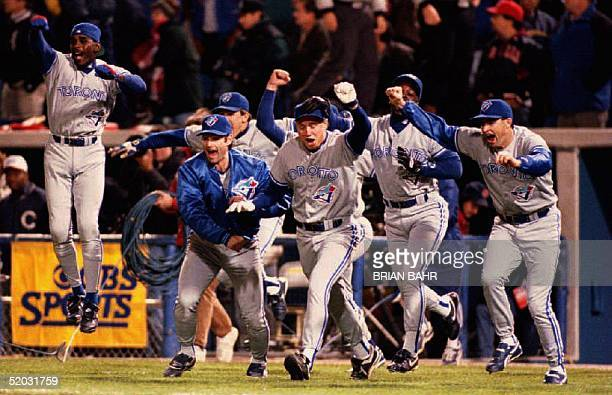 Toronto Blue Jays desiginated hitter Paul Molitor leads the charge out of the dugout 12 October 1993 after the Jays defeated the Chicago White Sox to...