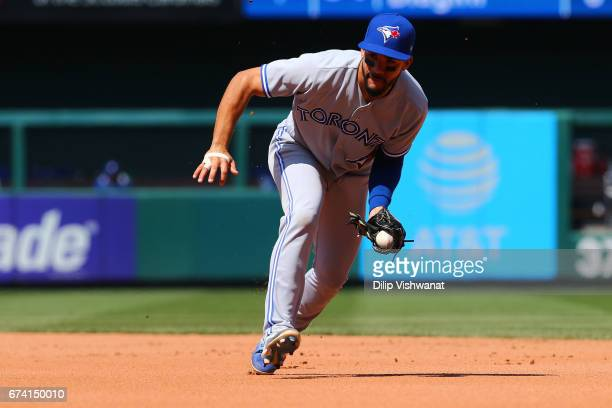 Toronto Blue Jays' Devon Travis of the Toronto Blue Jays fields a ground ball against the St Louis Cardinals in the seventh inning at Busch Stadium...