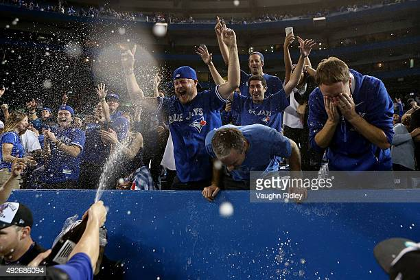 Toronto Blue Jays fans are sprayed with Prosecco after the Blue Jays 63 win against the Texas Rangers in game five of the American League Division...