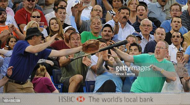 VT Toronto Blue Jays fans catch a flying bat from Cincinnati Reds Jerry Haiston in the sixth inning at the Rogers Centre Jays led 40
